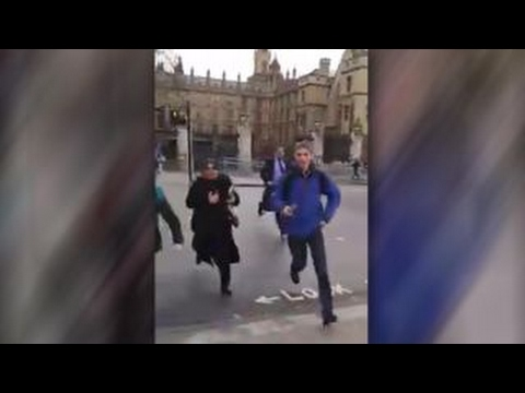 Video catches pedestrians running, shots fired in London