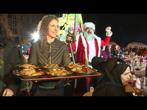 Lebanon Activists Serve Up Christmas Dinner In Beirut Protest Square | AFP