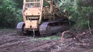 Caterpillar 983 clearing brush