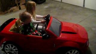 Ava and Joey Driving Their Red Convertible Mustang on Christmas Day