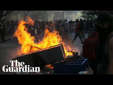 Shots fired at protesters defying curfew in Chile