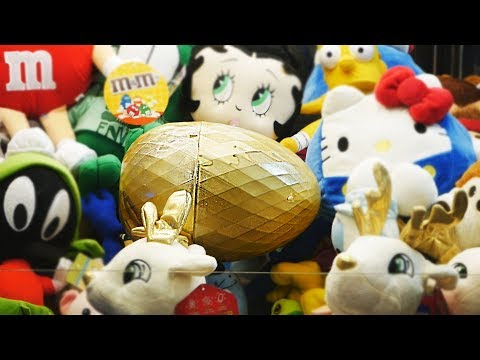 WON A GIANT GOLD EGG FROM THE CLAW MACHINE!    What's Inside?