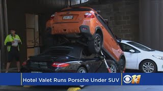 Hotel Valet Drives Porsche Under SUV