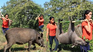 Two girls finding pig in forest  How to cooking pig and eating  primitive life KH