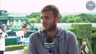 Dan Evans victory sets up third round battle with Federer