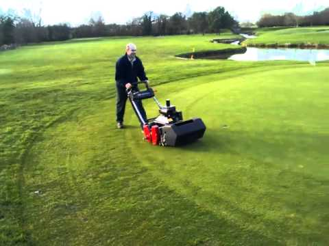 Course manager hand cutting greens