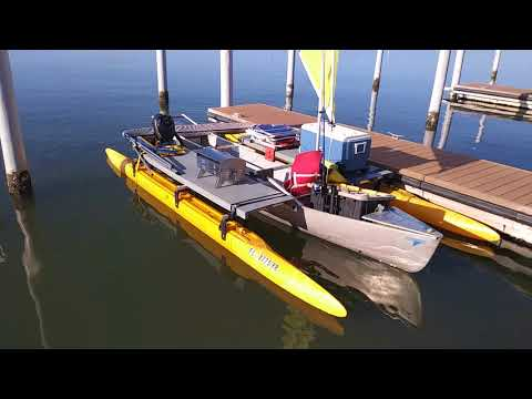 Outrigger canoe for camping and sailing.