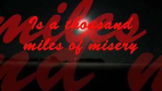 Dwight Yoakam thousand miles of misery lyrics