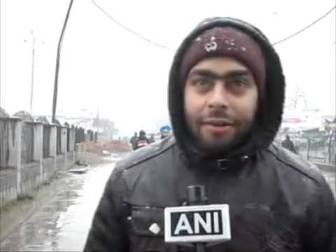 Residents welcome season's first snowfall in capital of Jammu and Kashmir