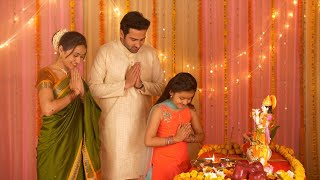 Happy Indian family celebrating Janamashtmi with love - Bowing with greeting pose