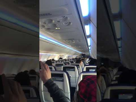 The Woody Show - How Annoying Is this Rapping Flight Attendant?