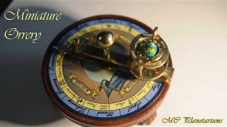 Brass & wood miniature orrery.