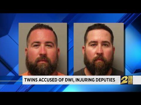 Twins accused of DWI, injuring deputies