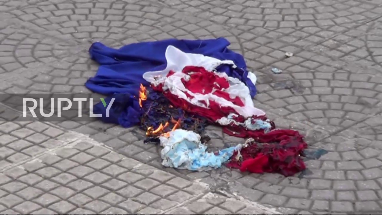 turkey protesters burn dutch or is it french flag after