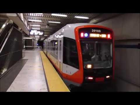 MUNI Metro: Brand-New LRV4 Train Arriving and Departing Civic Center