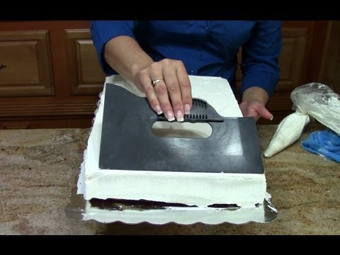 Cake decorating how to ice a 1 2 sheet cake in butter for Fomic sheet decoration youtube