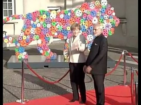 PM Modi received by German Chancellor Angela Merkel at Hannover Messe