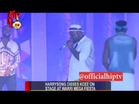 Harrysong blast's kcee while performing on stage.