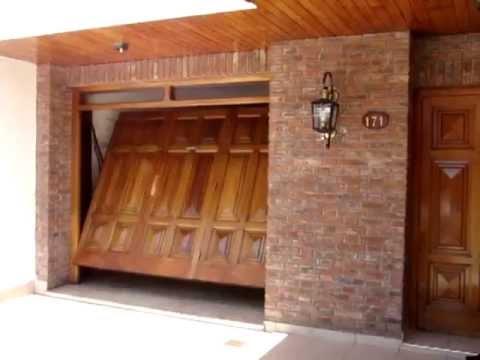 Portones fabrica gural port n levadizo de madera punta - Fabricas de madera ...