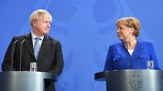 Boris Johnson meets Angela Merkel in Berlin