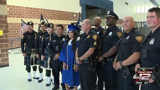 Video: Brothers in blue escort fallen officer's daughter in graduation ceremony