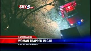 Woman trapped in car after wreck along I-35