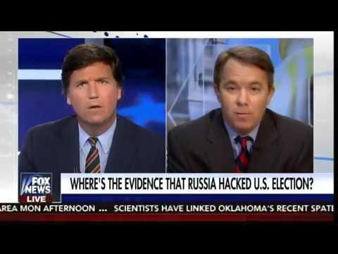 Tucker Carlson DESTROYS Liberal Paul Davies on Russian Hacking