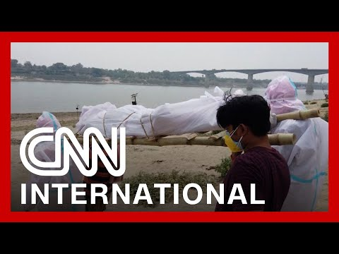 Makeshift crematoriums are built as India's crisis worsens
