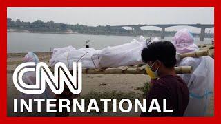 Download Makeshift crematoriums are built as India's crisis worsens