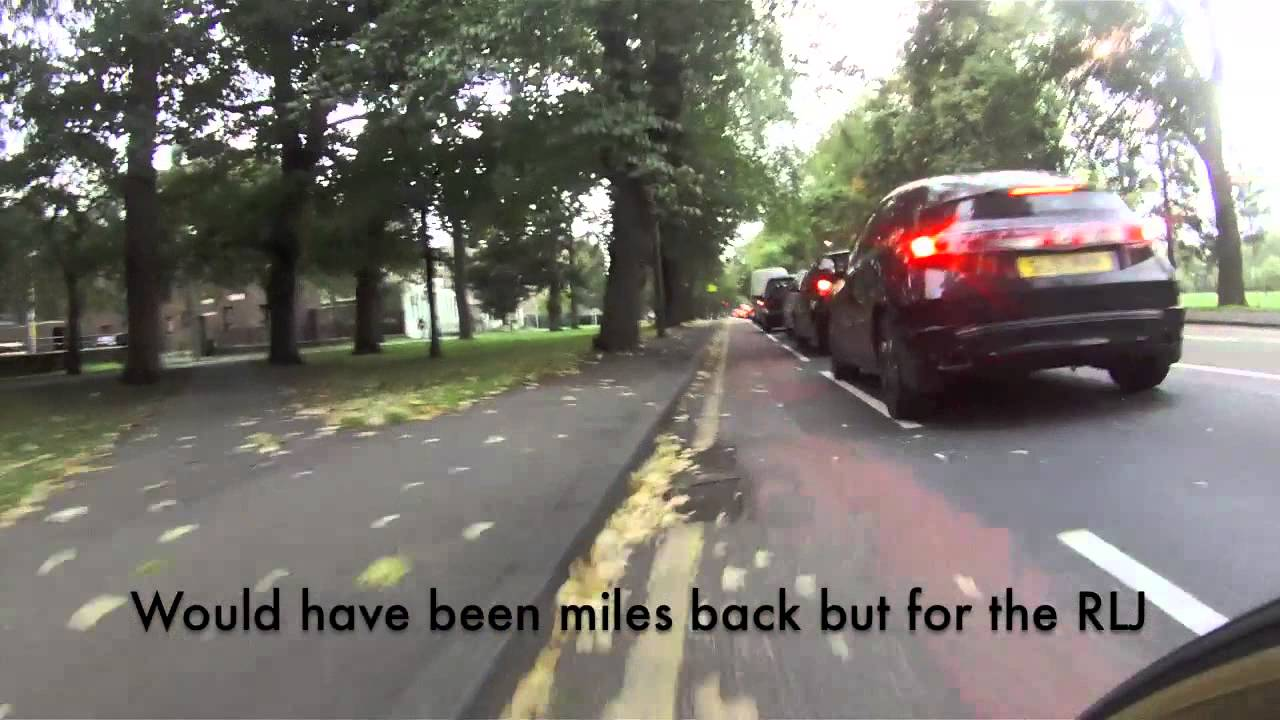 Cyclist Holding Up Traffic - YouTube
