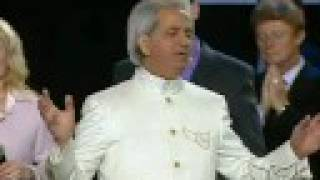 "Benny Hinn sings ""I STAND IN AWE OF YOU"""