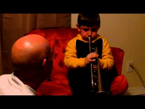 Mason playing the trumpet