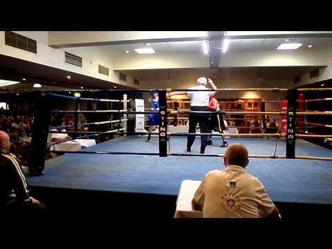 Flynn's first boxing fight - wins by TKO