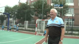 CITY IN CHINA 6: Mike Summerbee plays football on a visit to the SOS Children Village