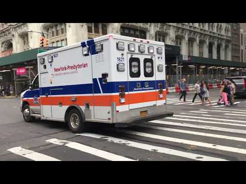 NEW YORK PRESBYTERIAN EMS AMBULANCE RESPONDING ON BROADWAY IN LOWER MANHATTAN, NEW YORK CITY.