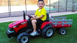 Lyndon Pretend Play with his Red Tractor Ride on Toy & Helps Uncle Tow Spiderman Car
