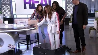 Can Adrienne Fit in a Suitcase?