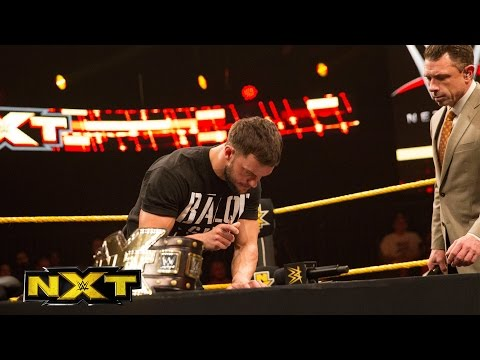 Finn Bálor and Samoa Joe sign the contract for TakeOver: London: WWE NXT, Nov. 25, 2015