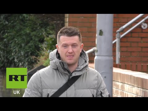 Tommy Robinson arrives at court for football banning order case
