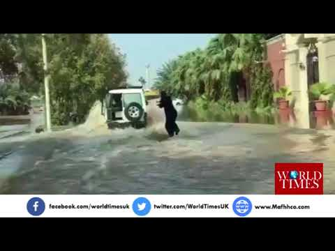 AMAZING Saudi woman from Jeddah surfs in the flood