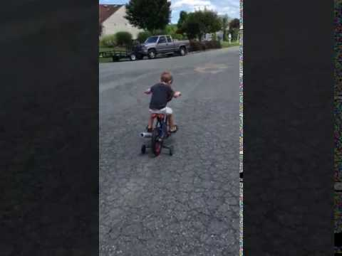 Isaac on bike
