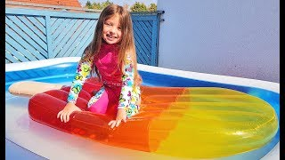 Kids play in the pool with funny toys by Richard show