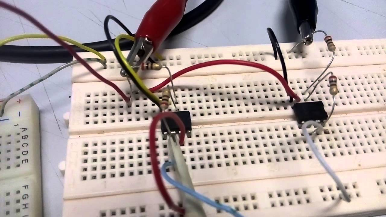 An Educator Making A Noninverting Op Amp Circuit On A Breadboard