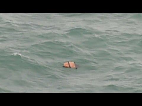 Search crews find bodies, debris from AirAsia Flight 8501