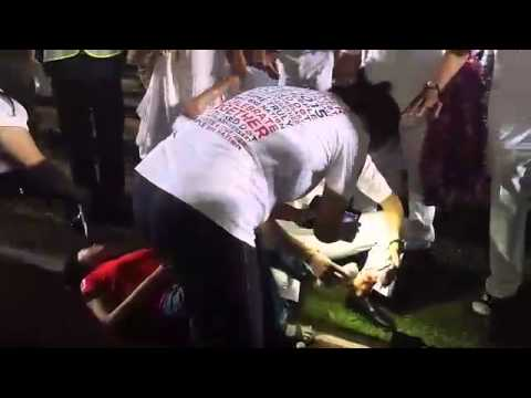 PAP's Dr Koh Poh Koon attends to injured supporter