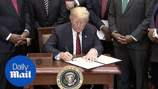 Trump signs order targeting development of 'Opportunity Zones'