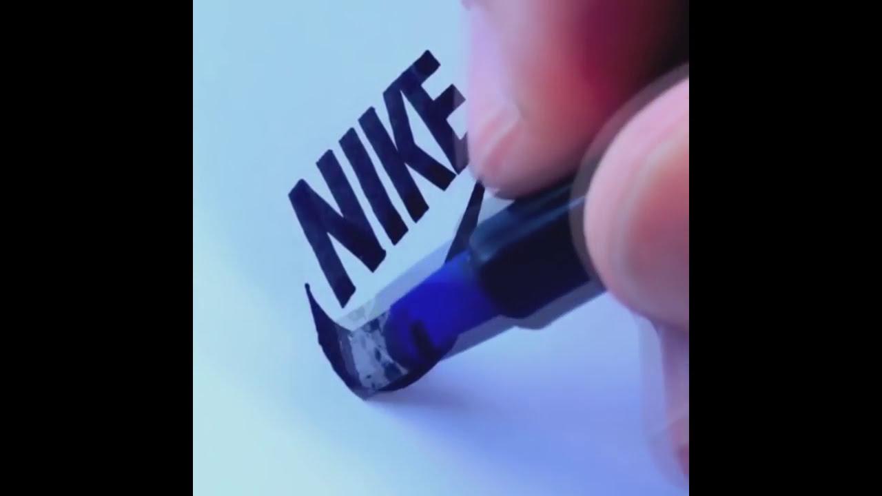 AMAZING! Artist Seb Lester freehand famous logos