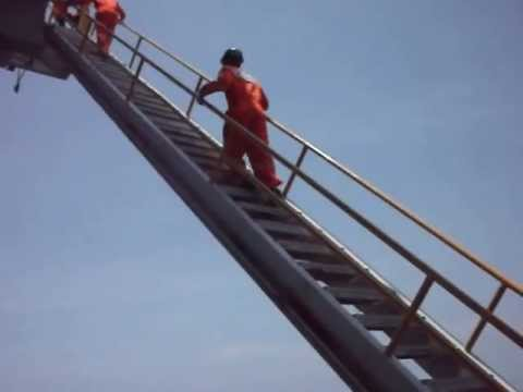 Offshore oil platform Indonesia. Upstairs to upper deck. A day in the offshore life