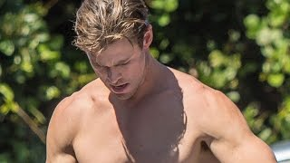 EXCLUSIVE: Chris Hemsworth Risks Swimming With Sharks, But Looks Super Sexy Doing It