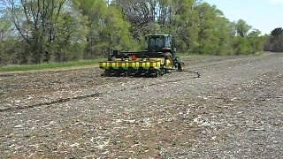 John deere 7610 and 1750 planting corn